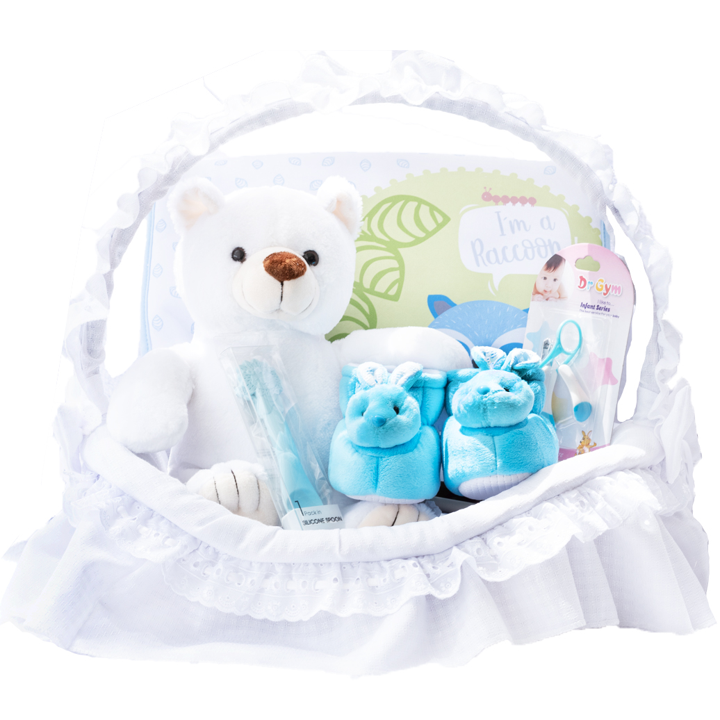 Canastilla para niño con oso de peluche cuchara de silicona y babuchas